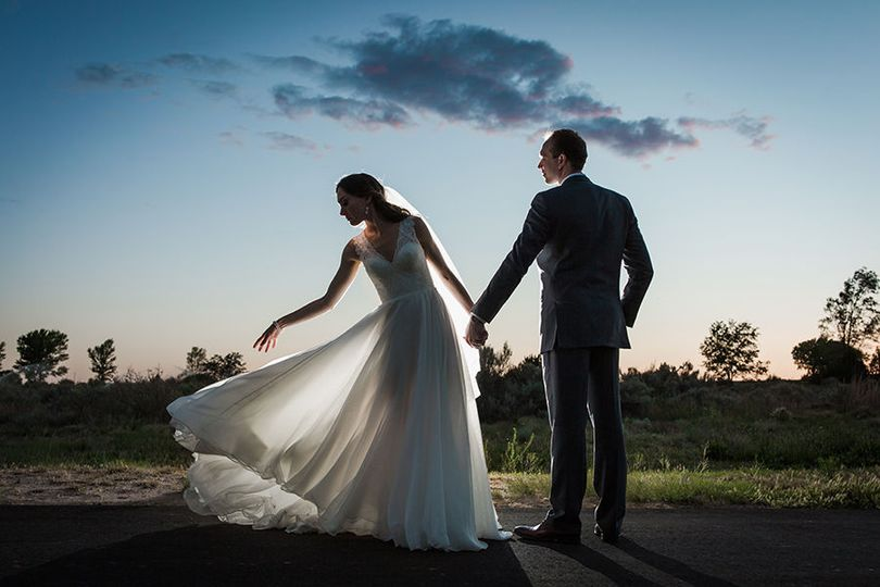 Couple standing at dusk