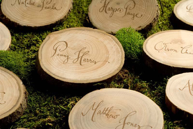 Wood slices as place cards for a rustic event.