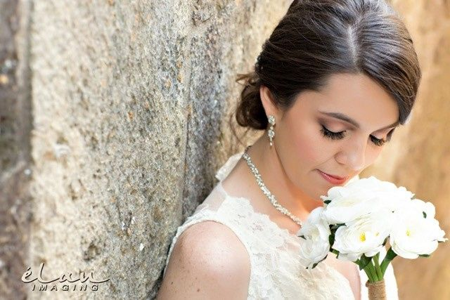 Bride smelling flowers