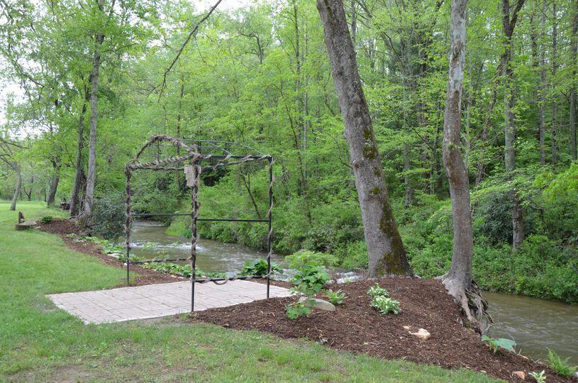 Metal arbor by the creek
