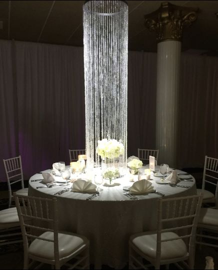 MARTINS CAMELOT UPPER MARLBORO, MD JULY 2017 Table setup with centerpiece