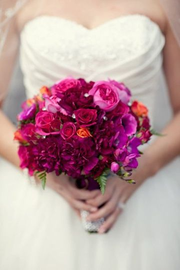 Raspberry and deep orange bridal bouquet