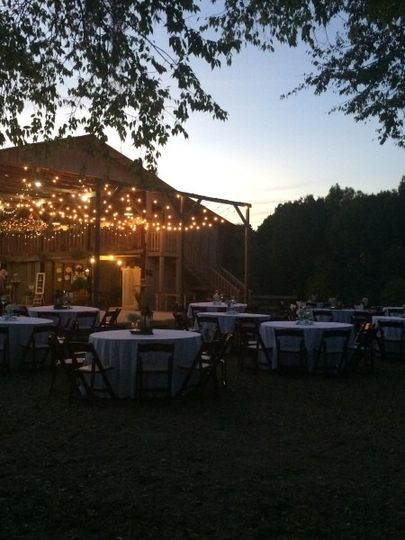 The view from the Ceremony Barn looking toward the Reception Barn at night.