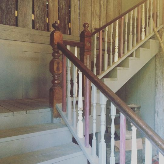 Rustic elegance and handcrafted old spindle barn wood stairs leading to the barn loft seating area.