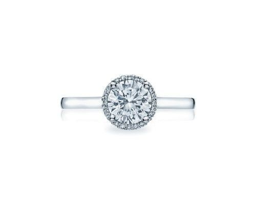 TACORI49rd65  A slim bloom of diamonds encircles a round center diamond for an elegant and modern...