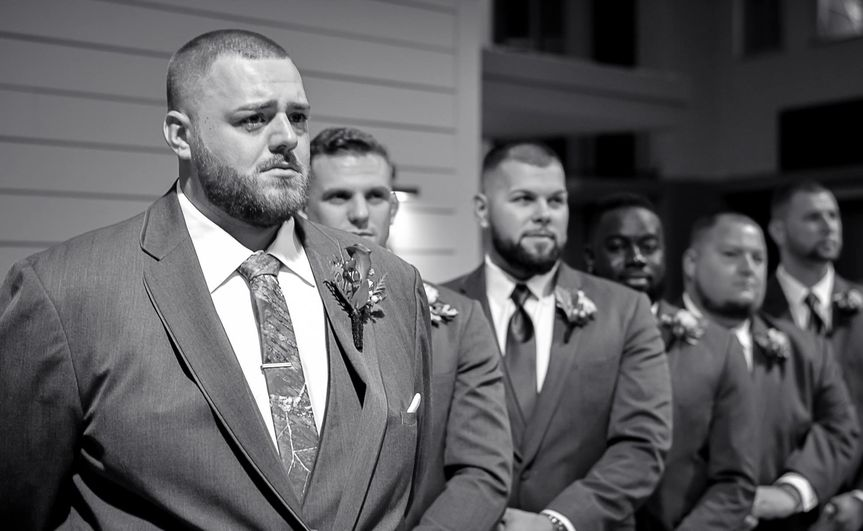 Groom and groomsmen in black and white shot