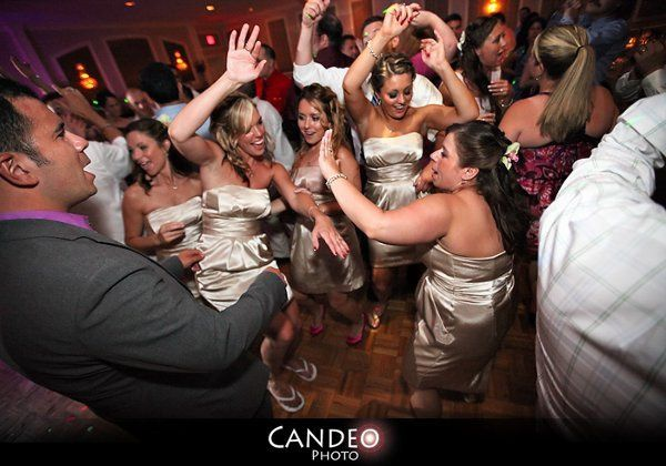 Bridesmaids dancing with the guests