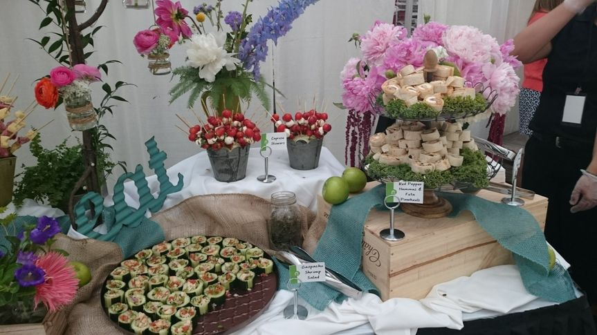A beautiful selection of appetizers and floral pieces from Gateway Market