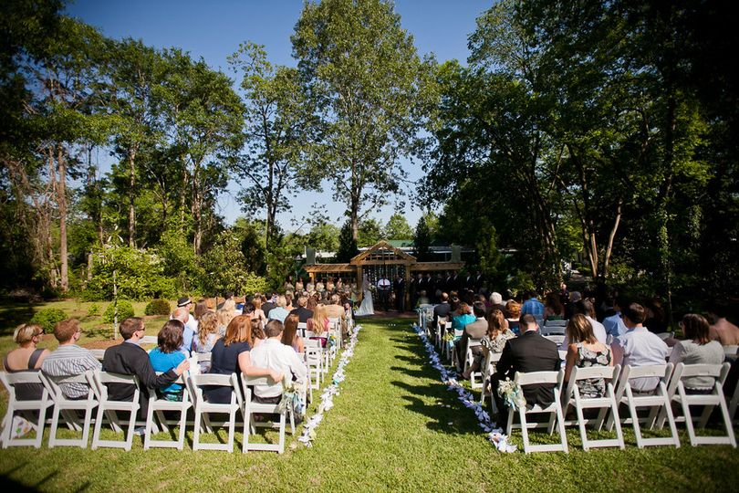 The Wedding Garden after passing under two arbors covered in Carolina Jasmine and looking toward the...