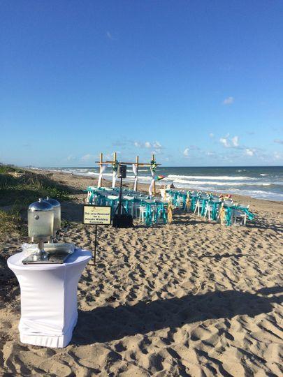 aqua white beach with water stand