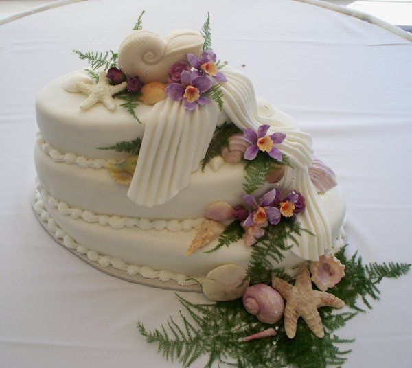Haley's Orchid Cake features oval tiers that are stacked in a step fashion.  Handmade sugar paste...