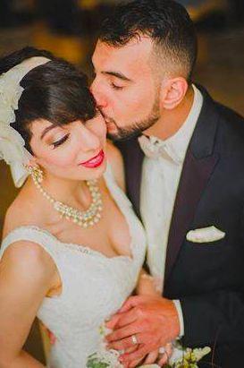 Bride kissed by groom