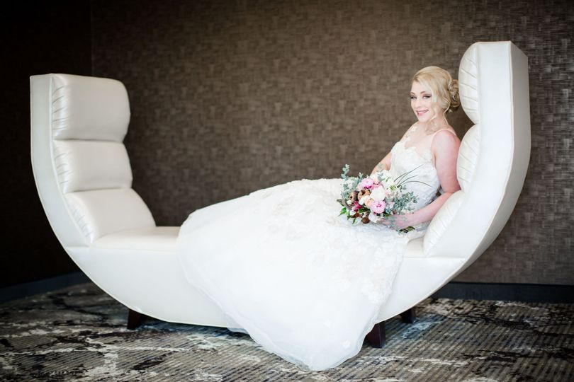 Bride on the couch | Photo by: Freeland Photography