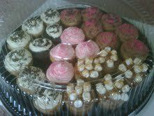 These cupcakes are a sampler of our delicious vanilla cupcake with chocolate frosting with pink...