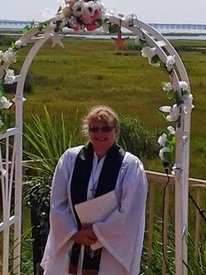 By the wedding arch