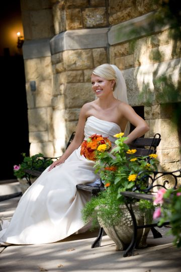 Bride sitting by the flowers