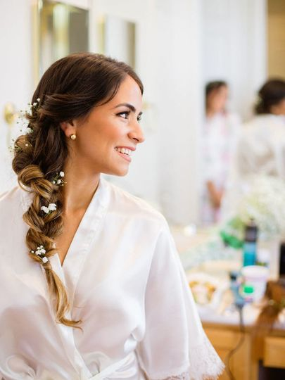 Side-swept dutch braid and temptu airbrush makeup for the bride.