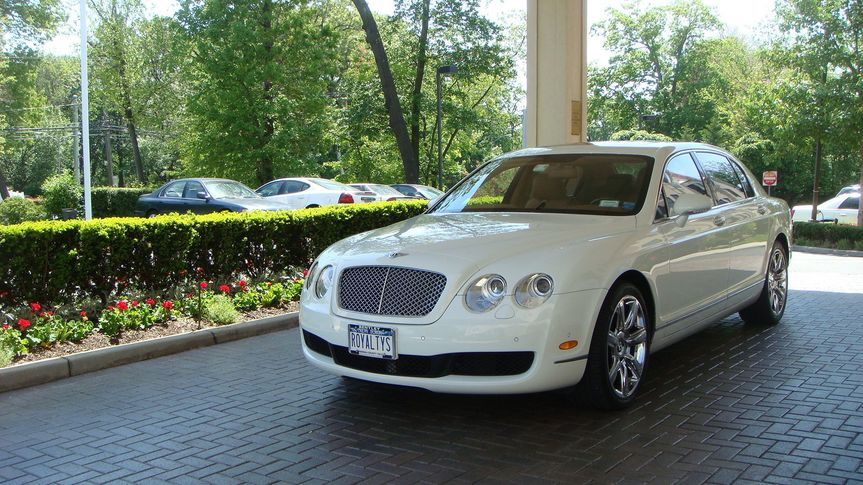 The Bentley Flying Spur is a great luxury sedan to add class and elegance to your special day.
