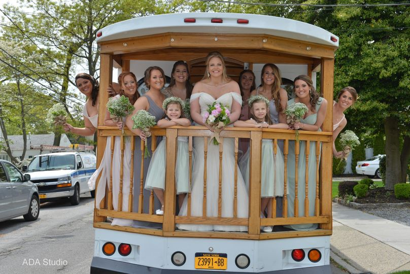 Our one of a kind trolley has a custom made caboose style back porch with beautiful oak railing. Our...