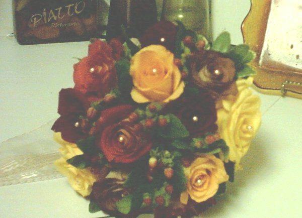 Fall colored Rose bouquet with black magic roses, leonidis rose, orange unique, and yellow roses.