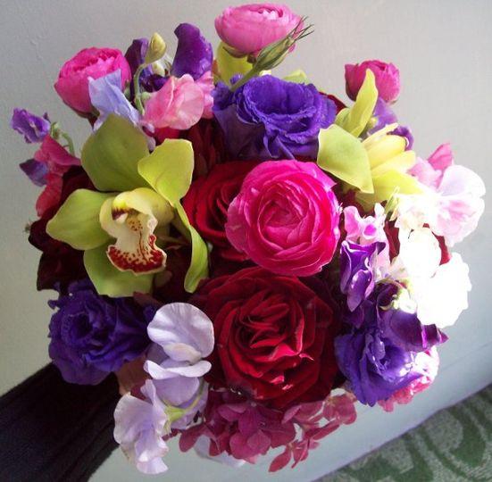 Round handtied using Green Cymbidium Orchids, Hydrangea, Ranunculus, Sweatpeas, Statice, Roses,...