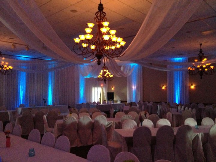 Reception hall chandeliers and blue uplights