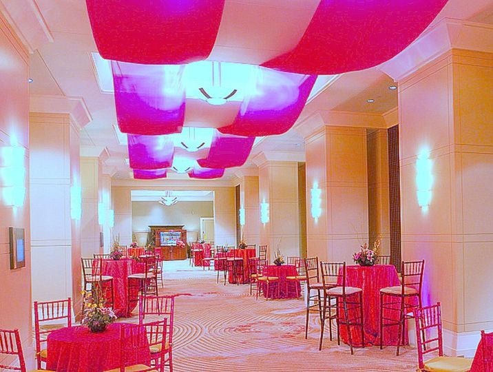 Pink reception table and ceiling decor
