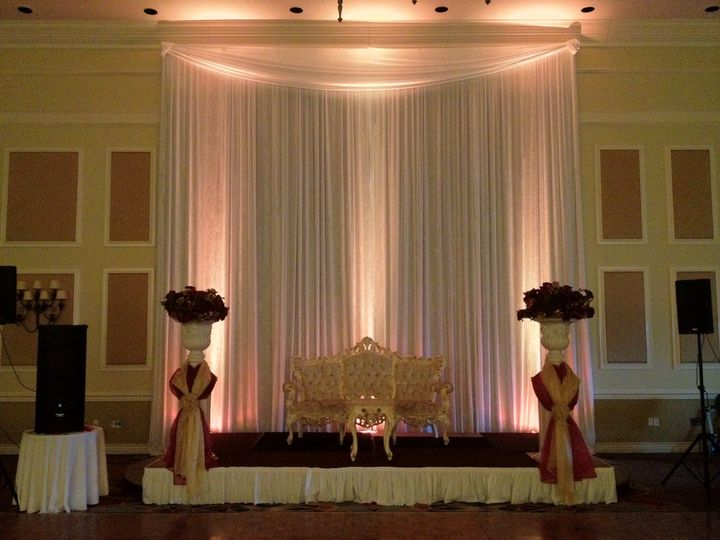 Stage uplights for the newlyweds