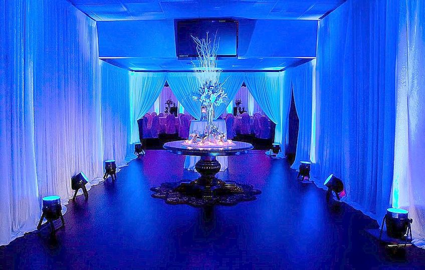 Blue lighting throughout the reception hall