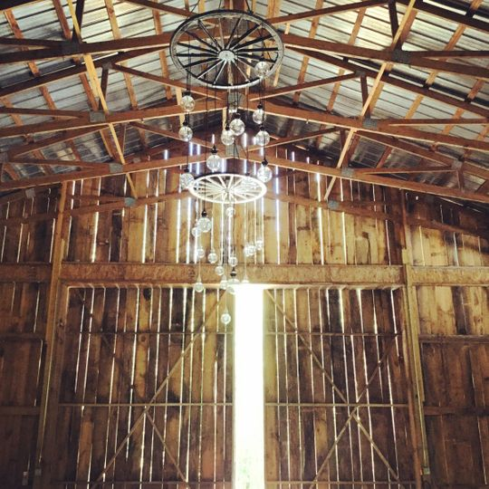 Wagon  wheel chandeliers hanging from soaring 24 foot ceiling