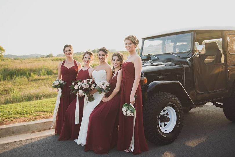 Bridesmaids chose different style of chiffon dresses in the same shade of burgundy.  Bouquets had...