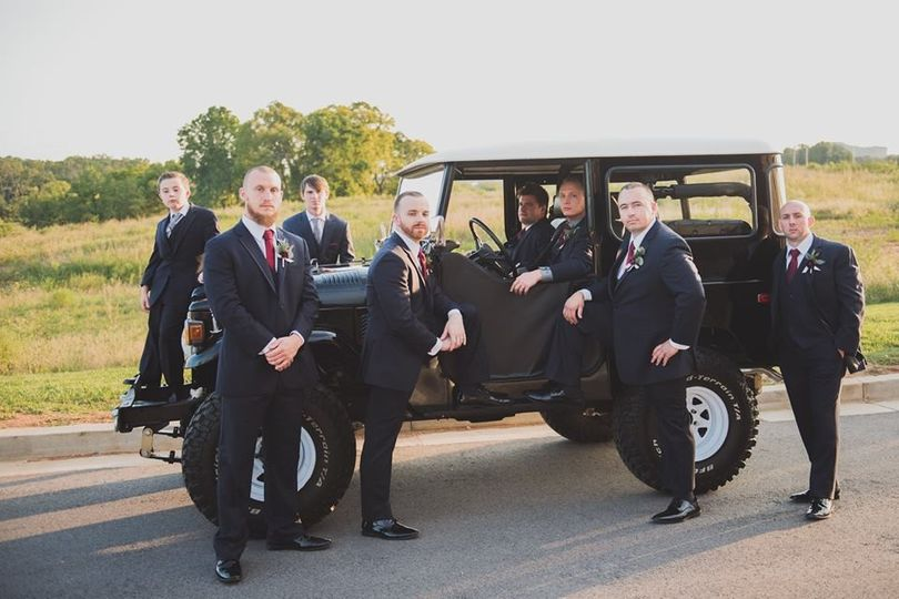 Posing with the Land Cruiser, the men chose charcoal suits with burgundy accents.