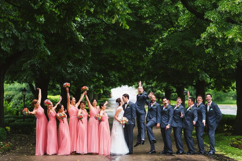 The couple with the bridesmaids and groomsmne