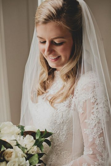 Bride in sleeved lace wedding dress