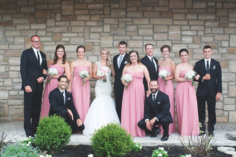 The couple with the bridesmaids and groomsmens