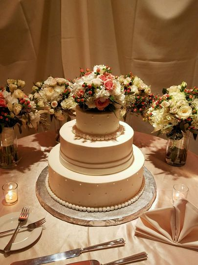 3-tier wedding cake with floral topping