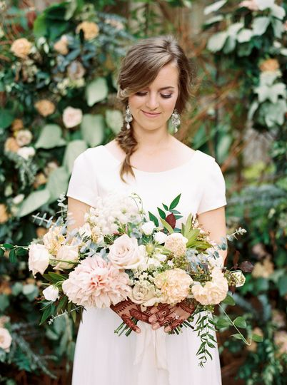 The bride holding a flower bouquet