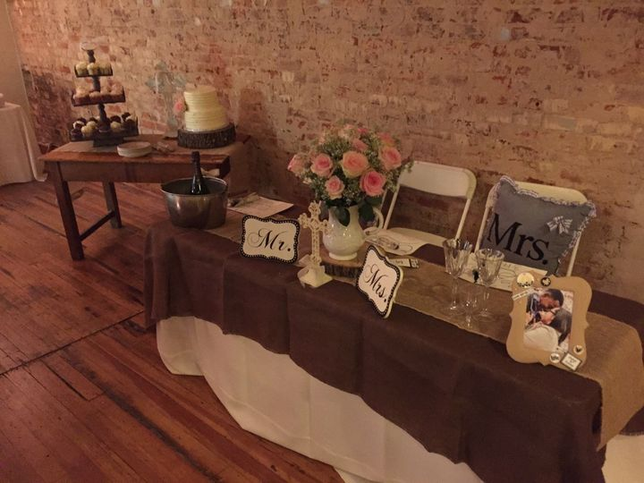 Beautiful brick wall accent.  6 footx 12 inch tables included in rental can be used alon (shown) or...