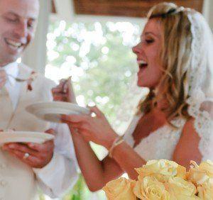Newlyweds feeding each other