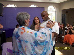 Officiant blessing a child