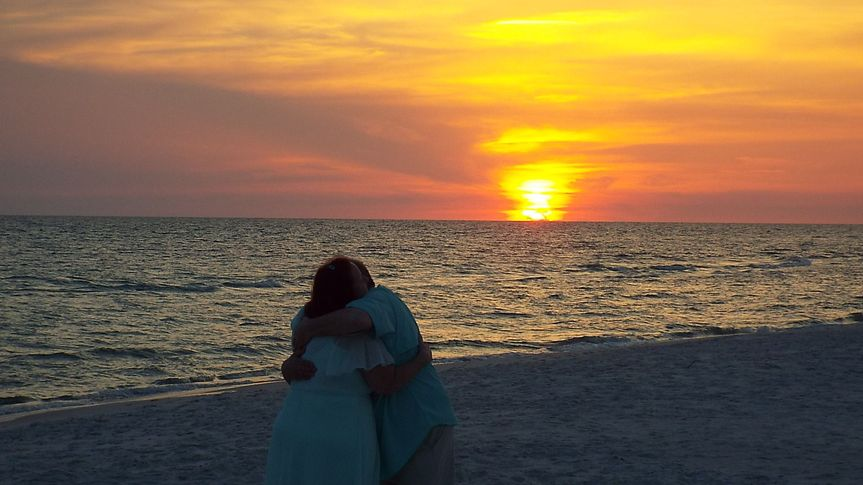 Hugging at sunset