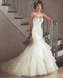 Beautiful organza gown from PC Mary's Moda Bella Collection.  In store sample is ivory size 14 but...