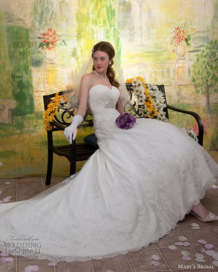 Traditional gown from PC Mary's Unspoken Romance Collection featuring chiffon and lace. This gown...