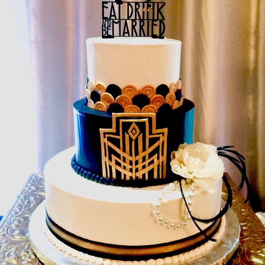 3-tier cake with a gold and blue tier