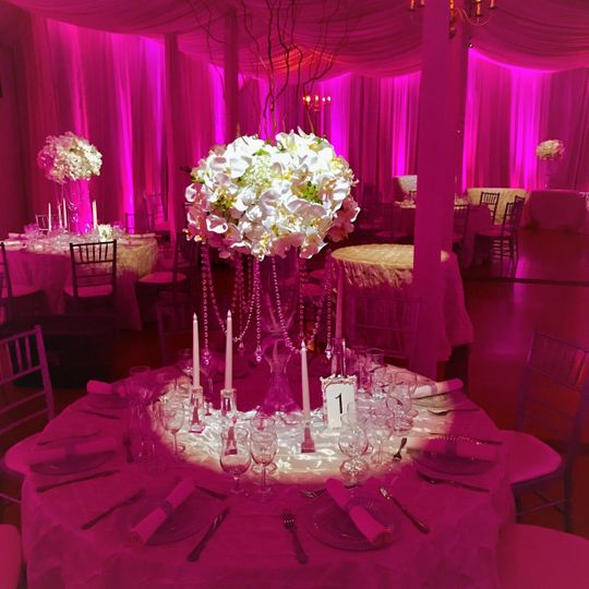 Lovely in lighting, linens, and matching florals.  The main ballroom envelopes the guests in this...