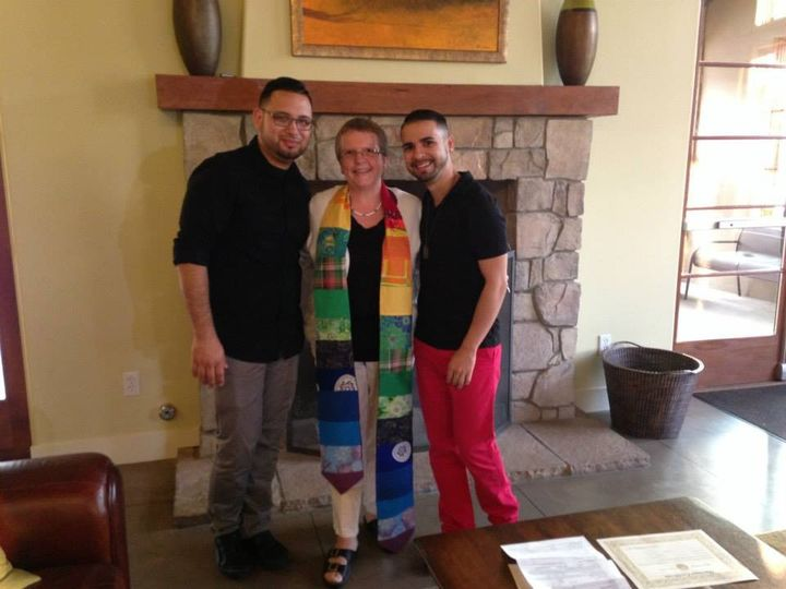 Couple with wedding officiant