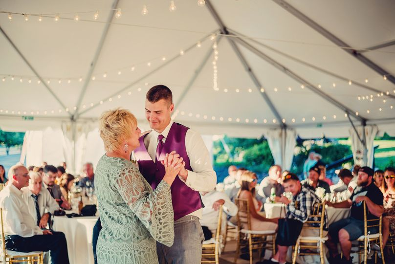 The groom and her mother dancing