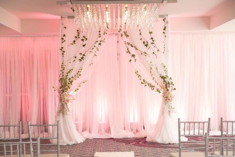 Wedding arch and drapes | PC: JJ Weddings