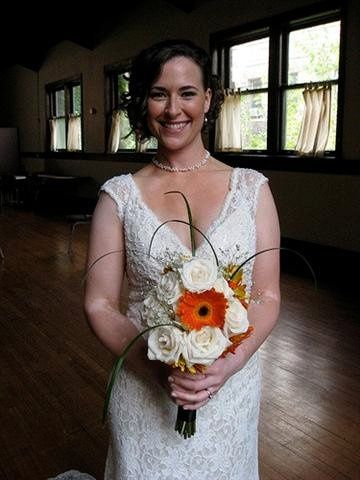 Grower's Box Customer Aimee R. looking absolutely stunning with her bridal bouquet of Gerbera...