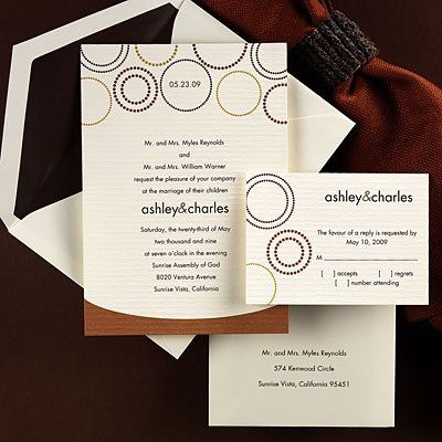 This stylish invitation features lightly textured ecru paper with dotted circle designs placed above...